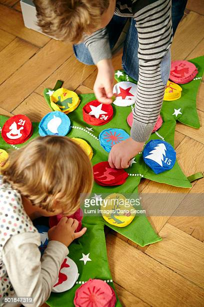 Children decorating Advent calendar, Munich, Bavaria, Germany