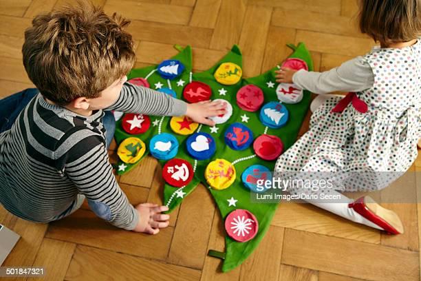 Children decorating Advent calendar, Munich, Bavaria, Germany