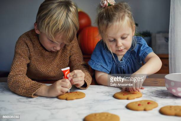 Children decorating biscuits