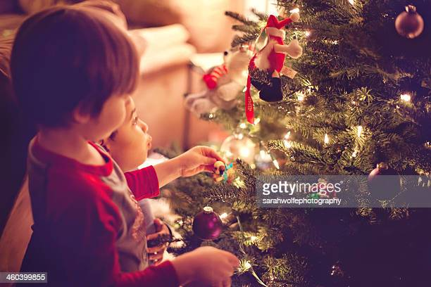 Children decorating Christmas tree