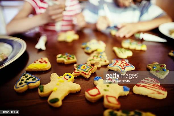 Children decorating icing biscuits