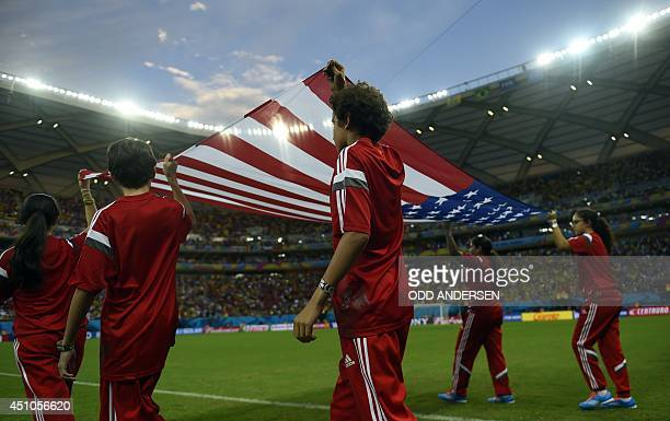 Children display the US flag before a Group G football match between USA and Portugal at the Amazonia Arena in Manaus during the 2014 FIFA World Cup...