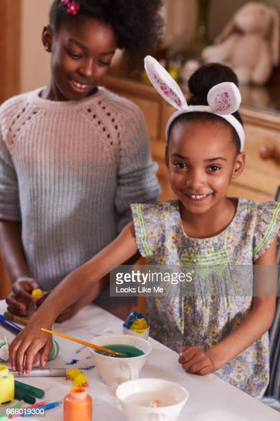 Children doing Easter crafts, painting Easter eggs.
