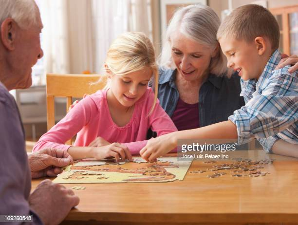 Children doing puzzle at table