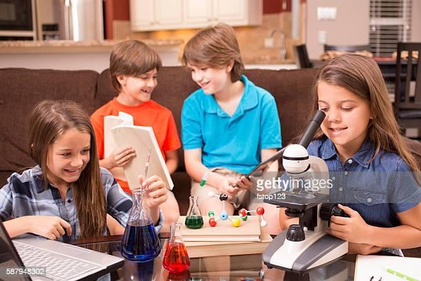 Children doing science homework at home.