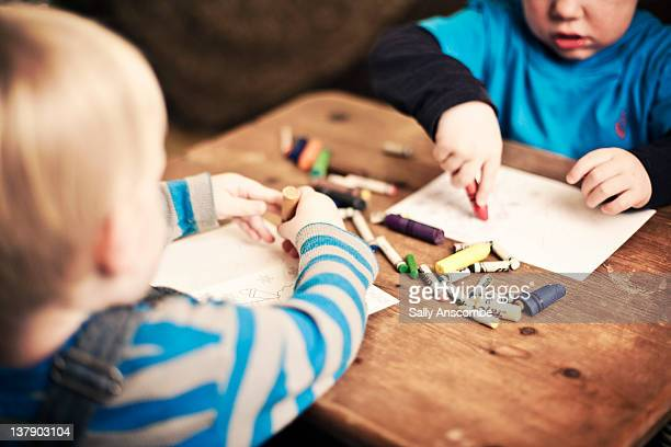 Children drawing and colouring in pictures