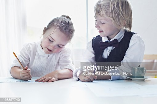Children drawing together at table : Stock Photo