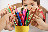 children drawing with crayons