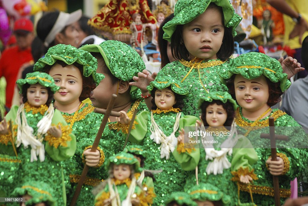 Children dressed as the Child Jesus sit amongst various images of the Santo Nino during the celebration the feast of Santo Nino procession in the district of Tondo on January 19, 2013 in Manila, Philippines. The annual Catholic celebration signals the start of festivities in various parts of the Philippines.