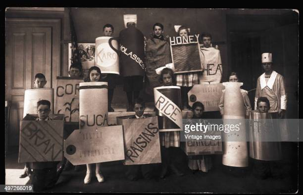 Children dressed as various foodstuffs in Leominster Massachusetts during World War I circa 1917 They represent such commodities as bran raisins rice...