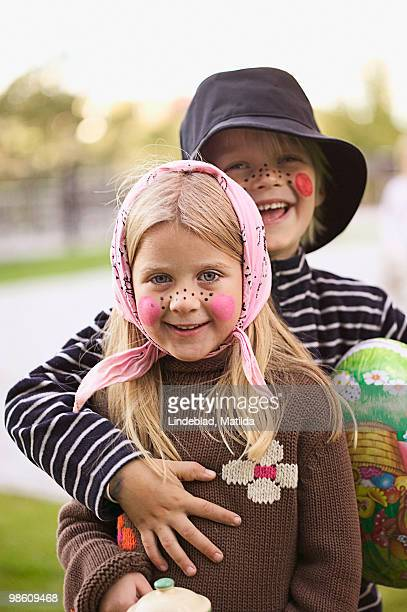 Children dressed up as an Easter witch, Sweden.
