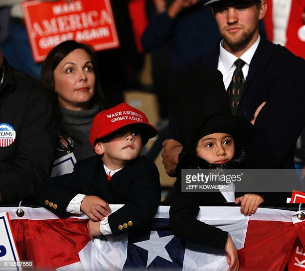 Children dressed up as Donald trump and former US President Abraham Lincoln wait to hear US Republican Presidential nominee Donald Trump address...