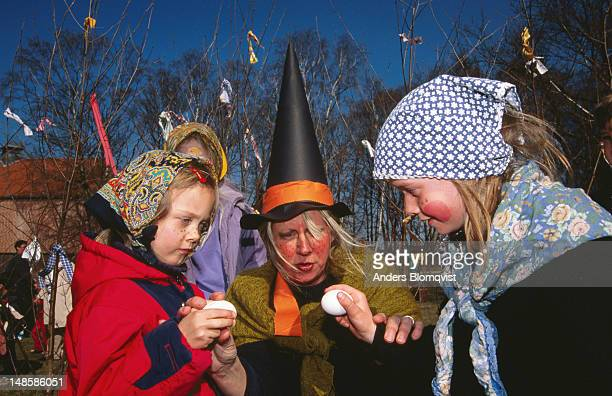 Children dressed up as Easter witches with eggs at Fredriksdal Open Air Museum.
