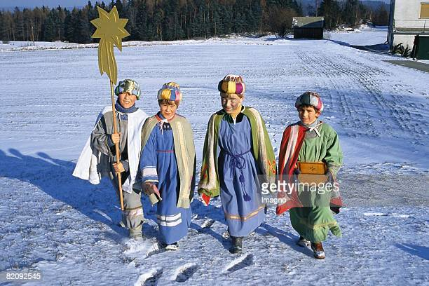 Children dressed up as the 'four Magi' of the Waldviertel in snowy landscape Austria Photograph Around 2004 [Kinder als die 'Heiligen Vier Knige' des...