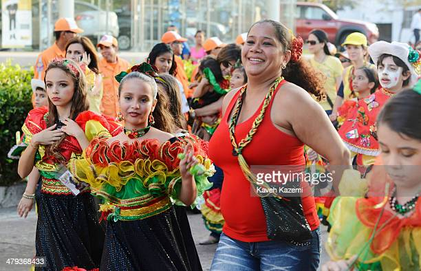 BARRANQUILLA COLOMBIA JANUARY 26 2014 Children dressed up for the occasion seen with their parents during the procession of Children's Carnival on...