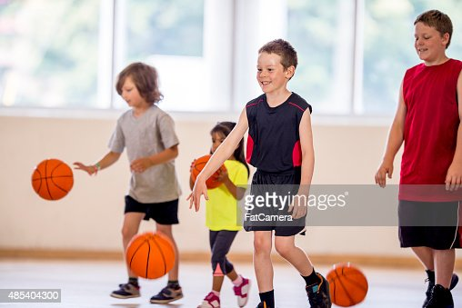 Children Dribbling a Basketball