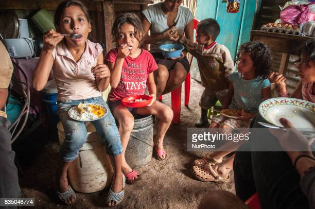 Children eat a bowl of Dipilto Viejo a traditional dish in Masaya Nicaragua on 19 October 2011