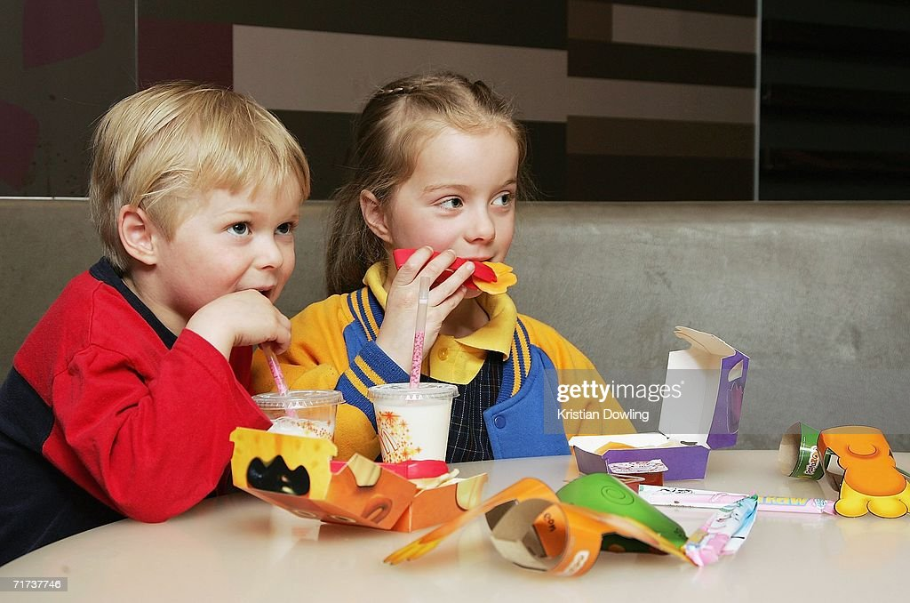 Children eat a new Happy Meal at the McDonald's restaurant in Collingwood on August 29 2006 in Melbourne Australia The new Happy Meal is a low fat...
