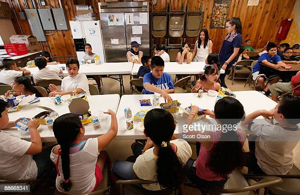 Children eat breakfast at the start of a day camp program at Casa Juan Diego St Pius V Youth Center June 24 2009 in Chicago Illinois The center...