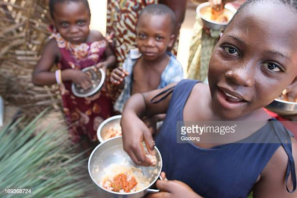 Children eating an african meal Togo