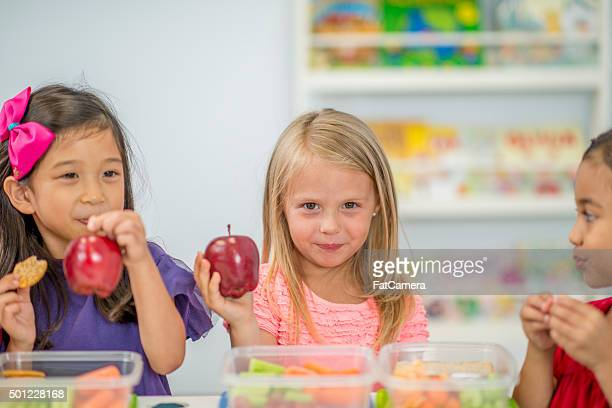 Children Eating Apples at Lunch