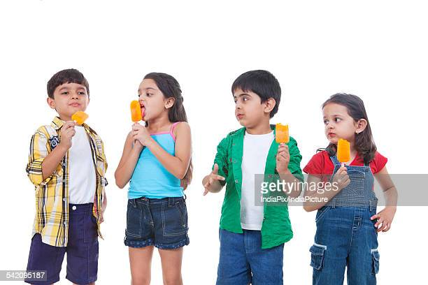 Children eating flavored ice