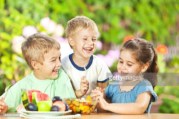 Children Eating Healthy Snack Outdoors