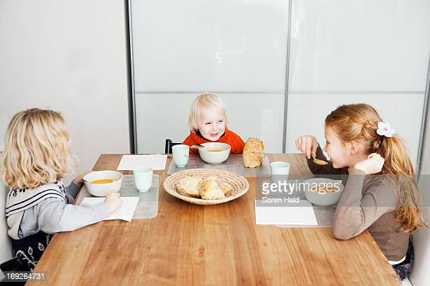 Children eating lunch at table