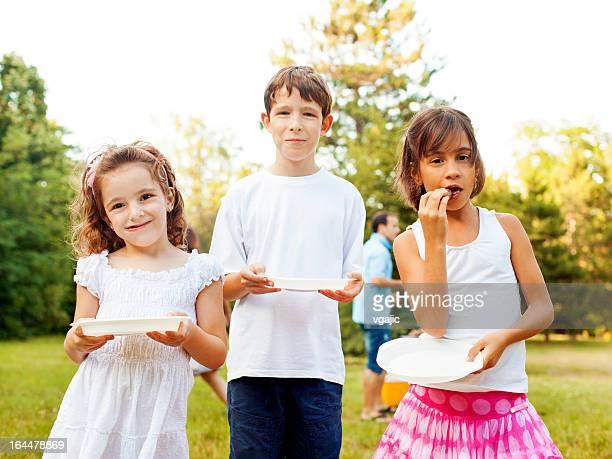Children Eating Outdoors.
