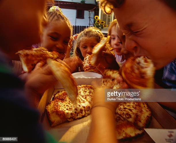 Children eating pizza at a party