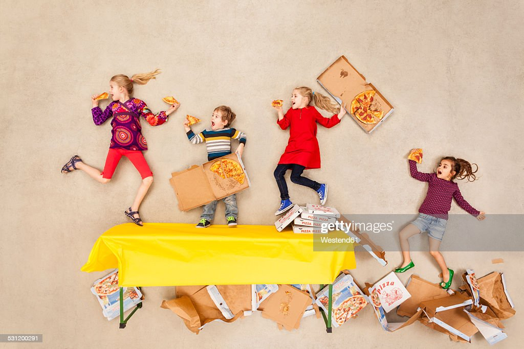 Children eating pizza at party