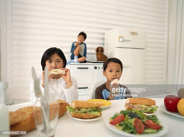 Children eating sandwich, portrait