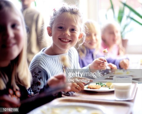 Children (6-8) eating school dinner, portrait