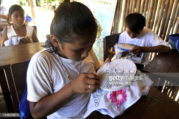 Children embroider during a class at the elementary school of San Pablo Village in the Isiboro Secure National Park and Indigenous Territory Bolivia...