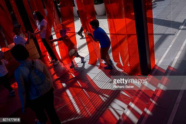 Children engage with the artwork called Arcadia on London's Southbank The PolyLester studio have created this artwork consisting of strips of...