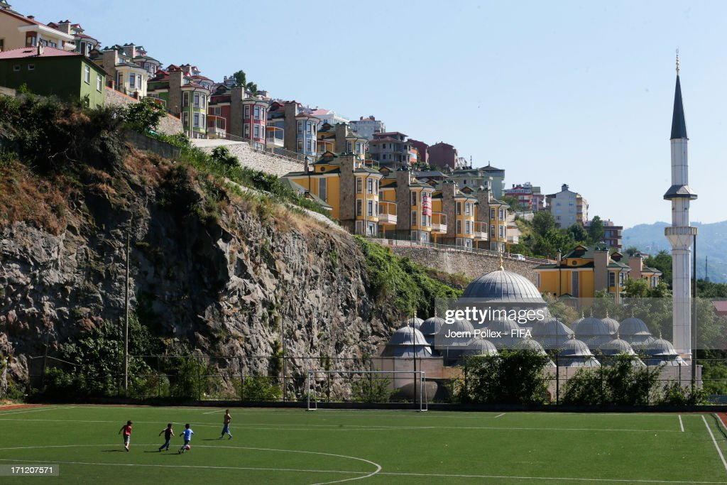 Children enjoy a game of football near the Boztepe Ottoman mosque on June 23, 2013 in Trabzon, Turkey.