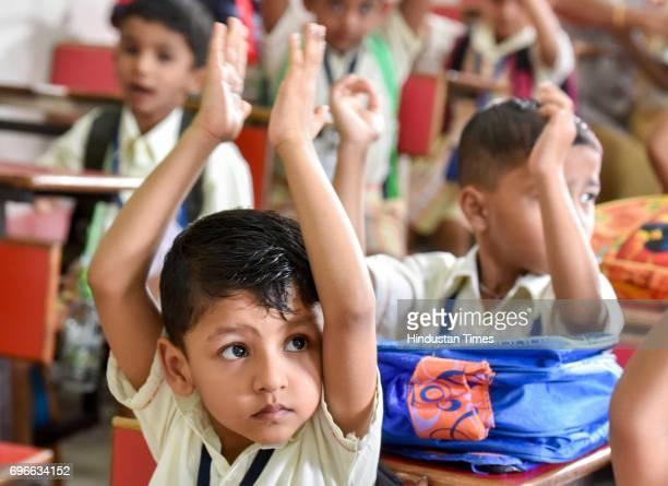 Children enjoy on the first day of school at Sane Guruji English Medium High School in Dadar on June 15 2017 in Mumbai India Attired in brandnew...