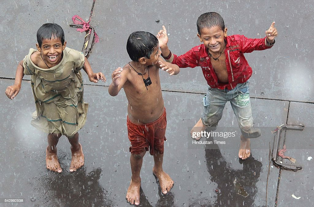 Children enjoys rainy season near Bandra station, on June 24, 2016 in Mumbai, India. Rains continued to lash Mumbai for the third consecutive day today, slightly disrupting suburban train services, even as the Met department predicted heavy showers. India Meteorological Departments Regional Meteorological Centre in Mumbai predicted intermittent rain with heavy to very heavy rainfall at a few place in the city and its suburbs for the next 24 to 48 hours.