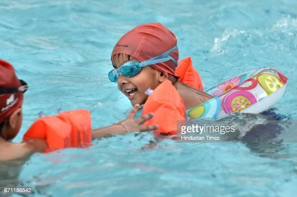 Children enjoy swimming to beat the heat at Baba Gangnath Swimming Pool Kendriya Vidyalaya Air Force Station Sector14 as temperature rises 42 Degree...