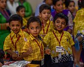 Children enjoy the first day after a summer vacation at IES Orion School at Dadar on June 15 2016 in Mumbai India Attired in brandnew uniforms the...
