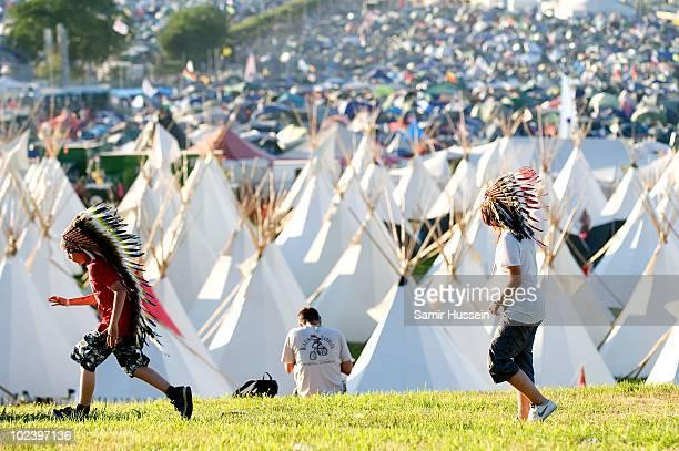 Children enjoy the Glastonbury Festival on June 24 2010 in Glastonbury England Glastonbury has become Europe's largest music festival and is...