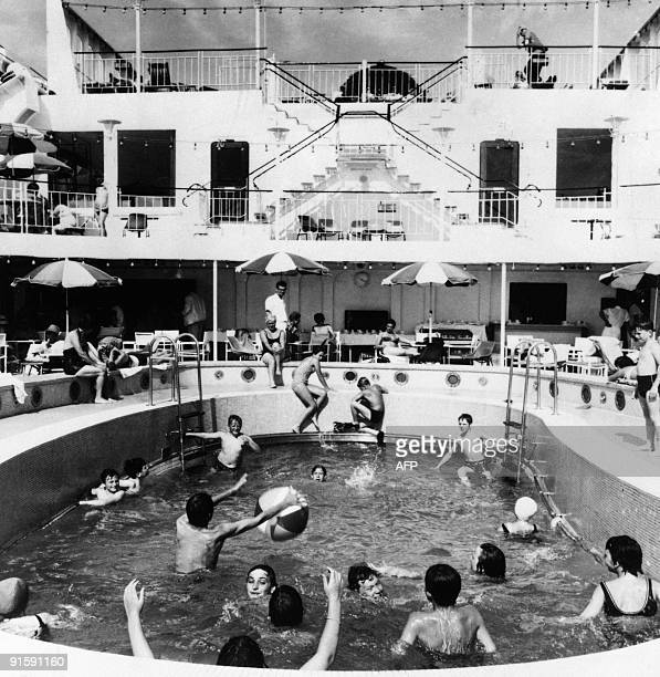 Children enjoy the swimming pool on the deck of the United Kingdom's Cunard liner Queen Elizabeth 2 on May 1969 in French harbor of Le Havre The...