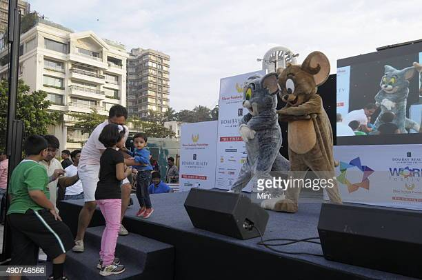 Children enjoy with the cartoon characters at Worli festival which is being celebrated at Worli Sea Face on January 27 2013 in Mumbai India The three...