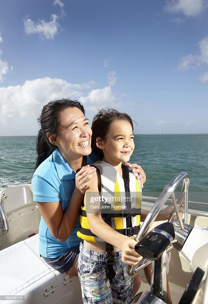 Children enjoying boating experience : Stock Photo