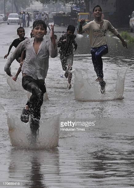 Children enjoying premonsoon rain on June 16 2013 in New Delhi India The national capital has been witnessing premonsoon showers recording 61 mm of...