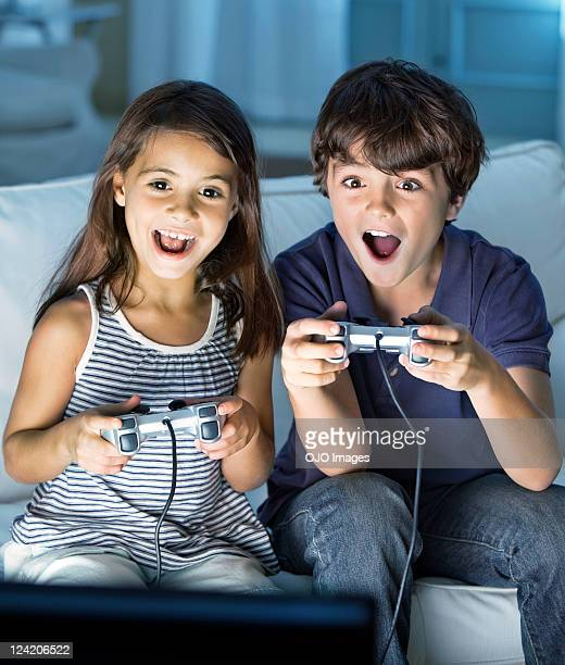 Children enjoying video game with mouth open