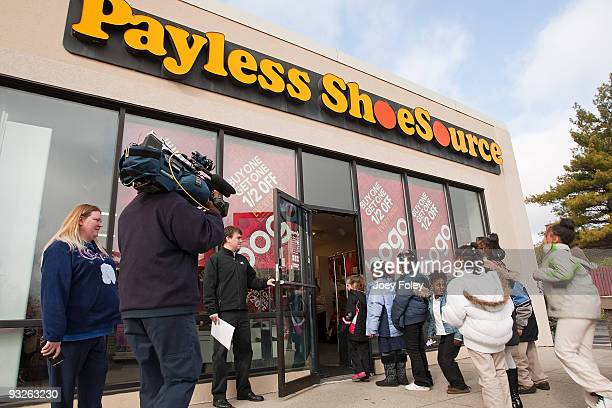 Children enter the store to use their coupons for free shoes as the media video tapes them at Payless ShoeSource on November 20 2009 in Cincinnati...