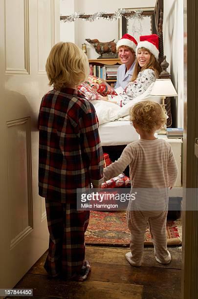 Children entering parents' bedroom at Christmas