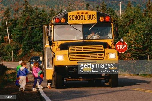 Children entering school bus : Stock Photo