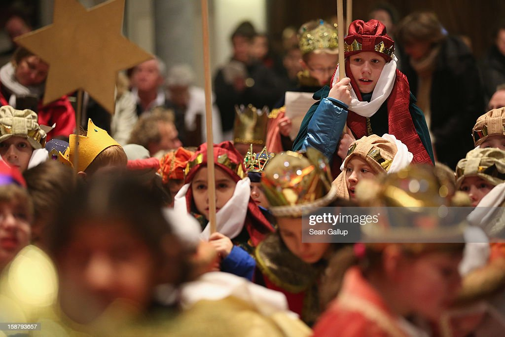 Children Epiphany carolers dressed as the three kings Balthasar, Melchior and Gaspar attend a religious mass ahead of their annual charity donation collection drive on December 29, 2012 in Berlin, Germany. The children will walk house to house in the days around January 6, singing carols and collecting money for needy children across the globe.